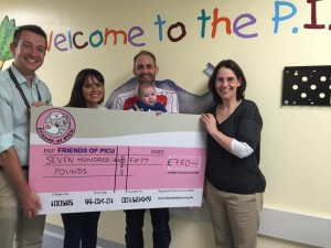 Cameron, Mummy & Daddy Presenting A Previous Cheque To Friends Of PICU.